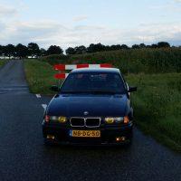 BMW e36 met USLights en gele koplampen