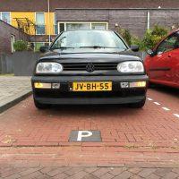 VW Golf 3 met USLights op parkeerplaats